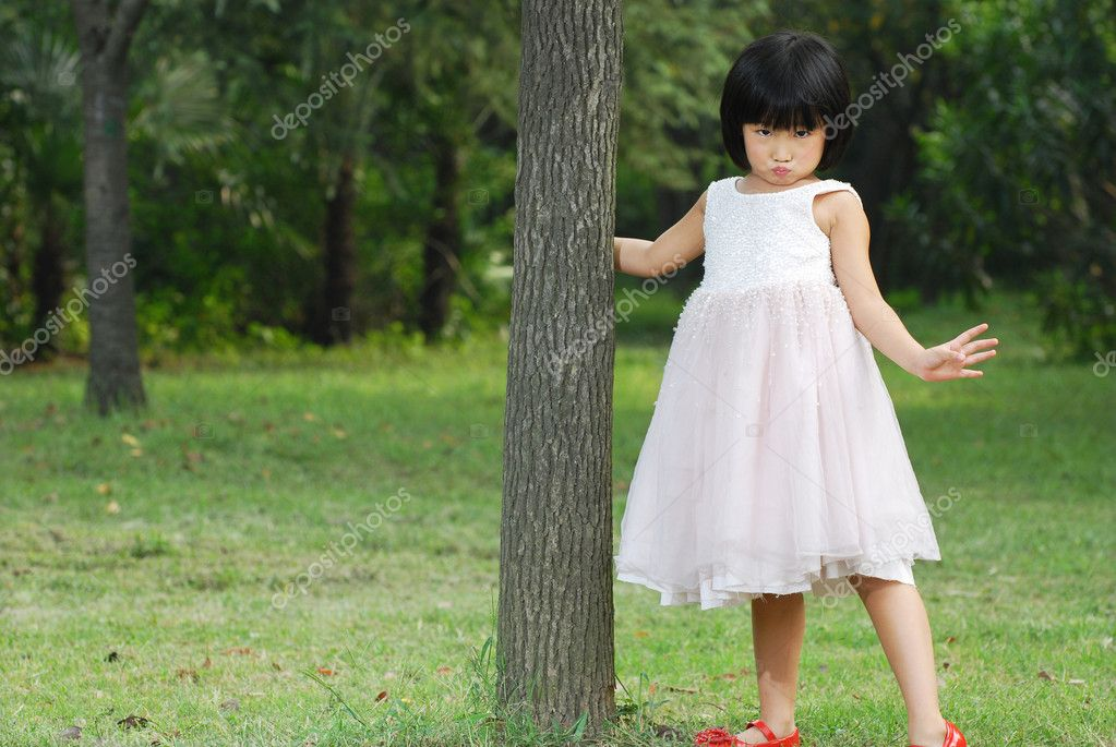 Cute asian child having fun in park  Stock Photo #10996924