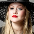 Portrait of the blonde in a black hat — Stock Photo #10946604