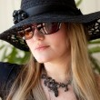 Portrait of the blonde in a black hat — Stock Photo