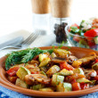 Roasted vegetables on a rustic plate. Salad with fresh vegetables in the background — Stock Photo