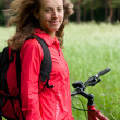Royalty-Free Stock Photo: Portrait of smiling happy woman cyclist