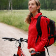 Woman cyclist on a bicycle walk on the park — Stock Photo