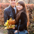 Happy smiling couple in autumn outdoors — 图库照片 #11220457