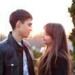Young couple in love in sunny outumn outdoors — ストック写真