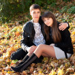 Young couple in love hug in autumn outdoors — Stok fotoğraf
