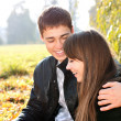 Happy smiling couple in love having fun autumn sunny day — Stock Photo