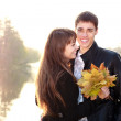 Happy smiling couple in love having fun bright day backlit — 图库照片
