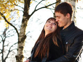 Happy young couple in love having fun autumn park — Stock Photo