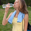 Portrait of young womdrinking water after outdoors workout — Stock Photo #11589973