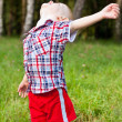 Excited happy child playing outdoor raised his head up — Stock Photo #11954755