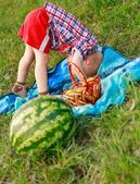 Cheerful child playing outdoor at a picnic — Stock Photo