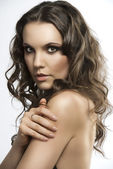 Pretty brunette with curly hair with hand on the shoulder — Stock Photo