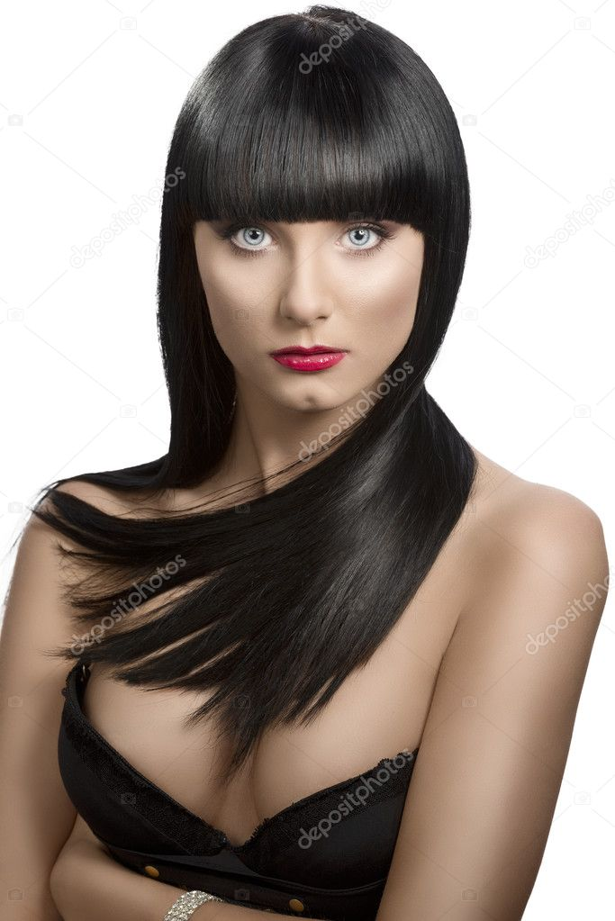 Pretty girl with long, dark smooth hair and fringe, she is in front of the camera wiuth crossed arms and looks in to the lens — Stock Photo #11373891