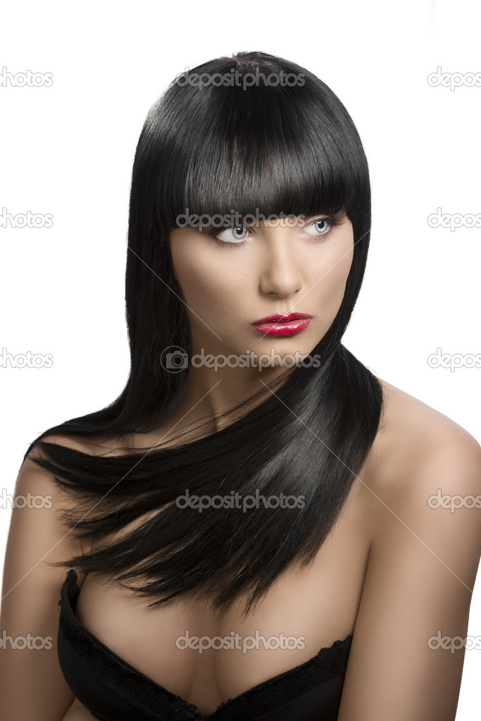 Pretty girl with long, dark smooth hair and fringe, she is in front of the camera and looks at left — Stock Photo #11374050