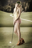 Sexy golf player woman, she looks in to the lens — Stok fotoğraf