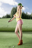 Sexy golf player woman with golf club on her shoulder — Stock Photo