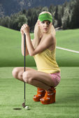 Sexy golf player woman folded down — Stock Photo