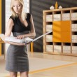Blonde business woman reads the classifier - Foto de Stock