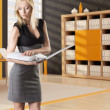 Blonde business woman reads the classifier - Stock Photo