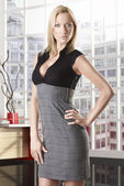 Blonde business woman with hand on the hip — Stock Photo