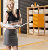 Blonde business woman reads the classifier — Stock Photo