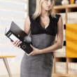 Blonde business woman takes classifier — Stockfoto