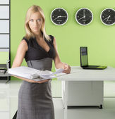 Blonde business woman with classifier — Stock Photo