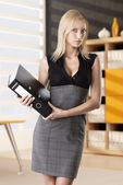 Blonde business woman takes classifier — Stock Photo