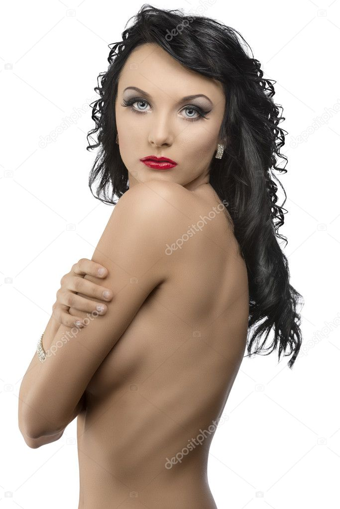 Pretty young woman with long dark wavy hair and crossed arms, her body is turned in profile, she looks in to the lens — Stock Photo #11655634