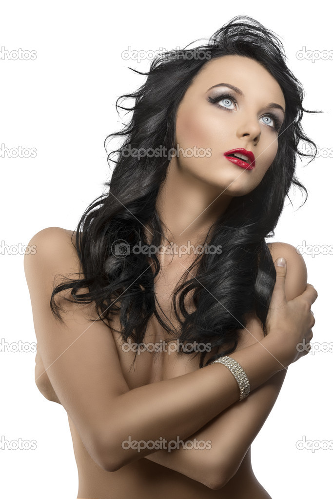 Pretty young woman with long dark wavy hair and crossed arms, she is in front of the camera, looks up with open mouth — Photo #11655710
