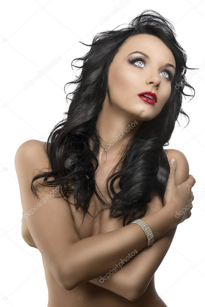 Pretty young woman with long dark wavy hair and crossed arms, she is in front of the camera, looks up with open mouth — Zdjęcie stockowe #11655710