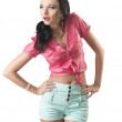 Pretty brunette with shorts looks at right — Stock Photo