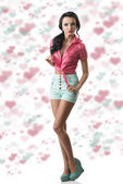 Pretty brunette with shorts in full lenght — Stock Photo