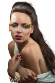Pretty brunette with feathered makeup with naked shoulder — Stock Photo