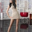 Pretty brunette with short dress with hand on the head — Stock Photo