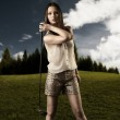 Beautiful woman with golfclub in the right hand — Stock Photo #12121330