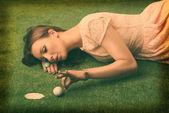Holga camera effect of an elegant golf girl — Stock Photo