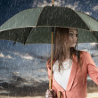 Stock Photo: Girl with umbrella, on sunset and under summer rain