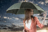 Girl with umbrella, on sunset and under summer rain — Foto Stock