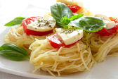 Italian pasta with tomatoes and cheese close up — Stock Photo