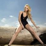 Beautiful blonde woman in black swimwear — Stock Photo #10797372