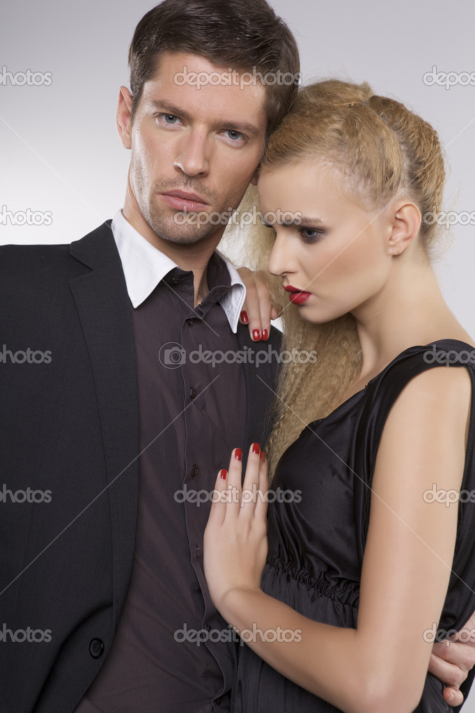 Portrait of elegant couple on grey background — Stock Photo #10797342