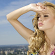 Beautiful girl on background blue sky — Stock Photo #10819491