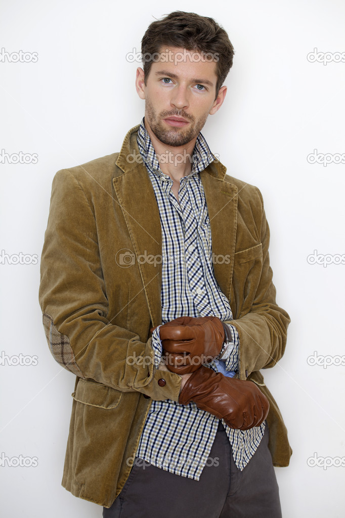 Close up portrait of handsome young man in brown jacket isolated on white background — Stock Photo #10819622
