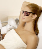 Young woman receiving laser therapy — Stock Photo
