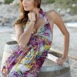 Beautiful brunette woman in romantic summer dress — Stock Photo #11587357