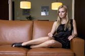 Blond woman in black dress — Stock Photo