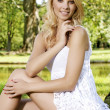 Blond wonam in the garden — Stock Photo