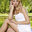 Blond wonam in the garden — Stock Photo #11999745