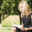 Young woman reading book — Stock Photo #12044019